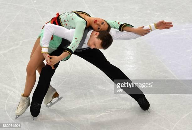 TOPSHOT Lola Esbrat and Andrei Novoselov of France compete in the pairs short program at the ISU World Figure Skating Championships in Helsinki...
