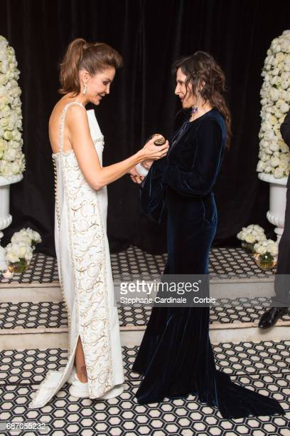 Lola KarimovaTillyaeva and Juliette Binoche at The Harmonist Party during the 70th annual Cannes Film Festival at on May 22 2017 in Cannes France