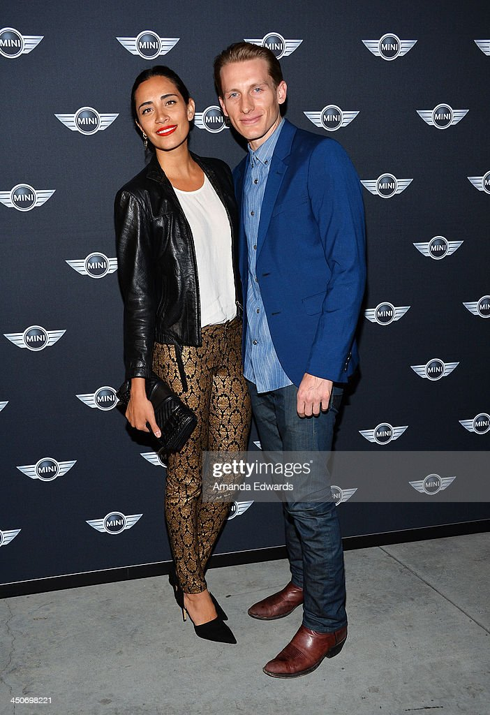 DJ Lola Langusta (L) and actor James Hebert arrive at the MINI Cooper red carpet premiere on November 19, 2013 in Los Angeles, California.