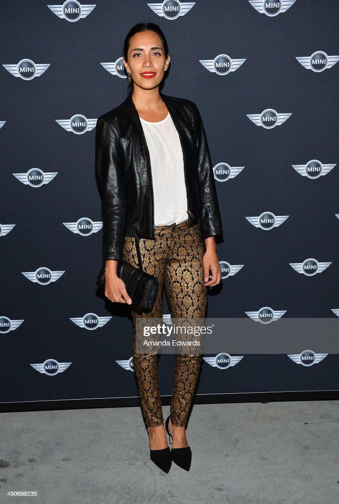DJ Lola Langusta arrives at the MINI Cooper red carpet premiere on November 19, 2013 in Los Angeles, California.