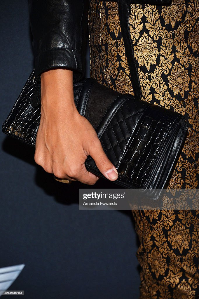 DJ Lola Langusta (clutch detail) arrives at the MINI Cooper red carpet premiere on November 19, 2013 in Los Angeles, California.