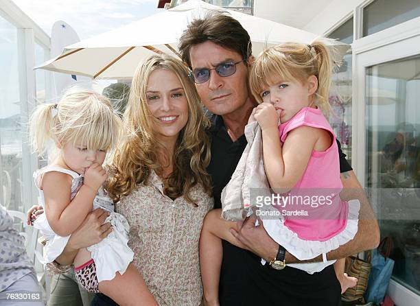 MALIBU CA AUGUST 25 Lola Sheen Actress Brooke Mueller Actor Charlie Sheen and daughter Sam Sheen attend the French Connection's 'Kids connection to...