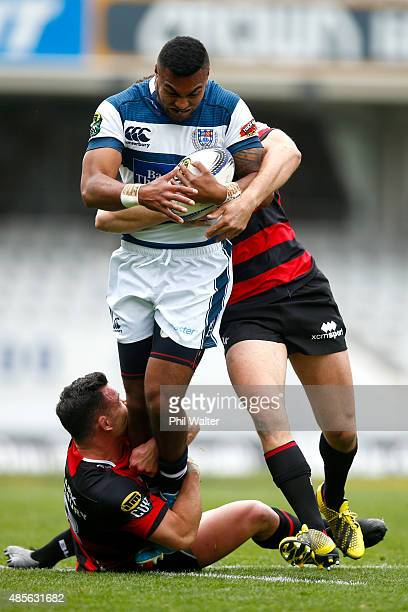Lolagi Visinia of Auckland is tackled by Ryan Crotty of Canterbury during the round three ITM Cup match between Auckland and Canterbury at Eden Park...