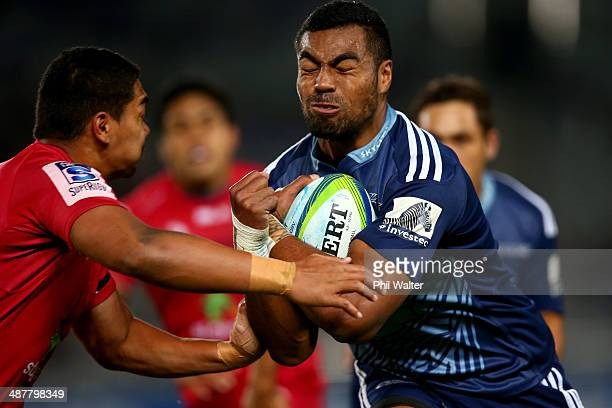 Lolagi Visinia of the Blues is tackled during the round 12 Super Rugby match between the Blues and the Reds at Eden Park on May 2 2014 in Auckland...