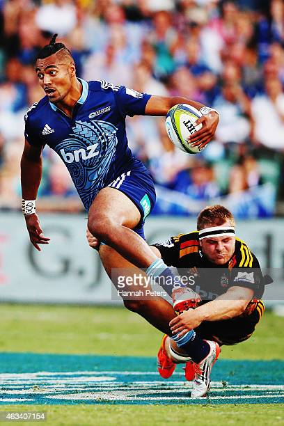 Lolagi Visinia of the Blues tries to get away from Sam Cane of the Chiefs during the round one Super Rugby match between the Blues and the Chiefs at...
