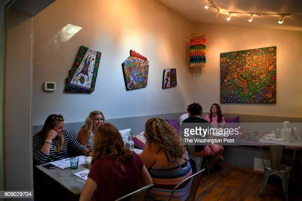 Lola's restaurant is a cozy little place in the bridge District of Charleston One of the dining rooms features the work of artist Charles Jupiter...