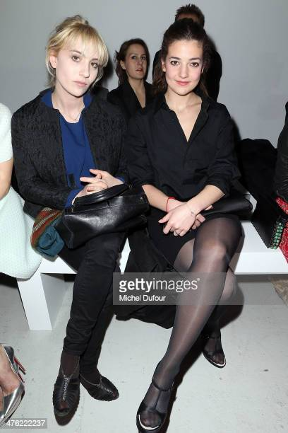 Lolita Chammah and Esther Garrel attend the John Galliano show as part of the Paris Fashion Week Womenswear Fall/Winter 20142015 on March 2 2014 in...
