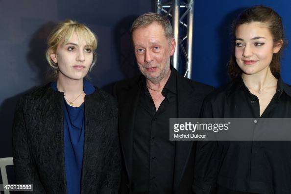 Lolita Chammah Bill Gaytten and Esther Garrel pose after the John Galliano show as part of the Paris Fashion Week Womenswear Fall/Winter 20142015 on...