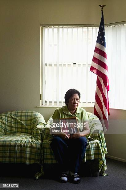 Lolita Eugenio poses with a photograph of her deceased husband Vicente Eugenio April 13 2005 in San Francisco Mr Eugenio served in the Philippine...