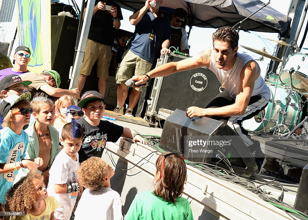 Lollapalooza founder <a gi-track='captionPersonalityLinkClicked' href=/galleries/search?phrase=Perry+Farrell&family=editorial&specificpeople=213012 ng-click='$event.stopPropagation()'>Perry Farrell</a> introduces Bad Things during Lollapalooza 2013 at Grant Park on August 3, 2013 in Chicago, Illinois.