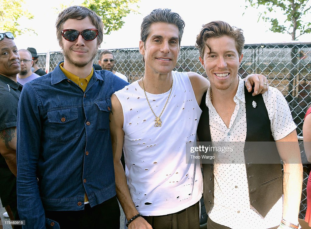 Lollapalooza founder <a gi-track='captionPersonalityLinkClicked' href=/galleries/search?phrase=Perry+Farrell&family=editorial&specificpeople=213012 ng-click='$event.stopPropagation()'>Perry Farrell</a> (Center) poses Davis LeDuke and Shawn White of Bad Things during Lollapalooza 2013 at Grant Park on August 3, 2013 in Chicago, Illinois.