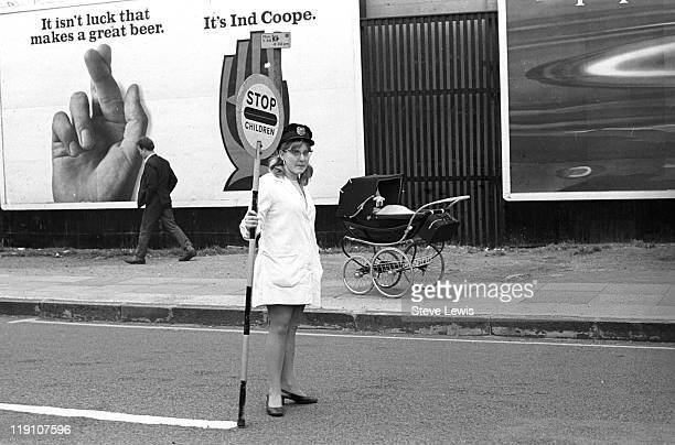 A lollipop lady at work in east London circa 1970