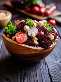 Fresh Lollo Rosso salad with chickpeas, tomato, radish and croutons