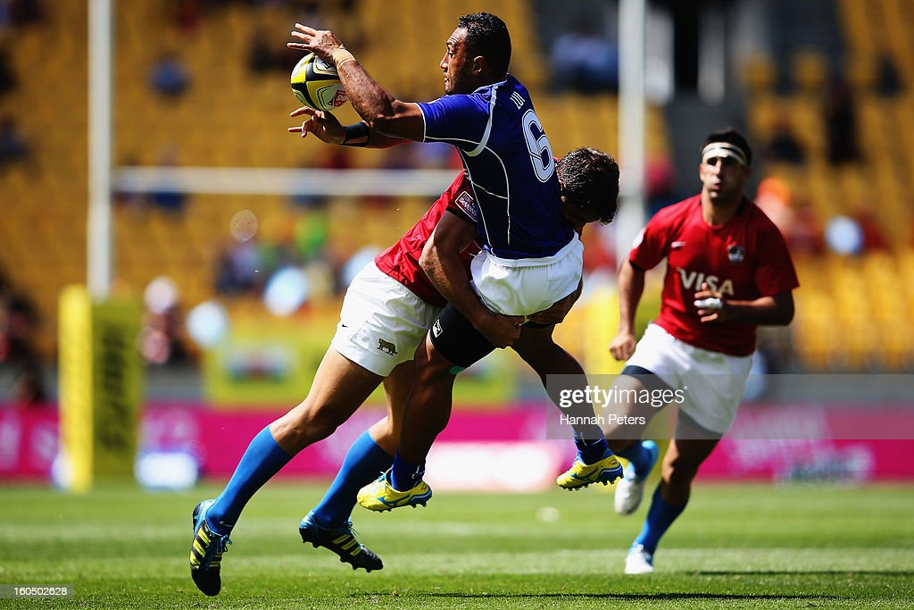 <a gi-track='captionPersonalityLinkClicked' href=/galleries/search?phrase=Lolo+Lui&family=editorial&specificpeople=577160 ng-click='$event.stopPropagation()'>Lolo Lui</a> of Samoa offloads the ball the quarterfinal cup match between Samoa and Argentina during the 2013 Wellington Sevens at Westpac Stadium on February 2, 2013 in Wellington, New Zealand.