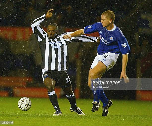 Lomana Lua Lua of Newcastle is challenged by Matt Elliott of Leicester during the FA Barclaycard Premiership match between Leicester City and...