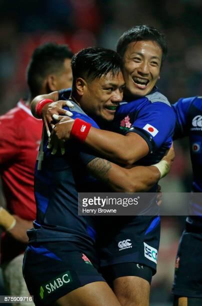 Lomano Lemeki of Japan celebrates with Yutaka Nagare of Japan during the international match between Japan and Tonga at Stade Ernest Wallon on...