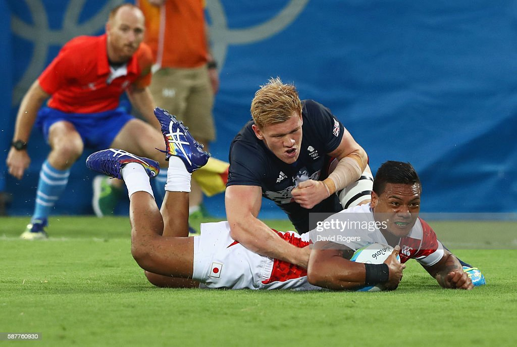 Lomano Lemeki of Japan scores a try during the Men's Rugby Sevens Pool C match between Great Britain and Japan on Day 4 of the Rio 2016 Olympic Games...