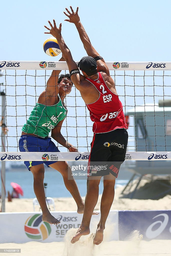 Lombardo Ontiveros of Mexico (L) spikes the ball past <a gi-track='captionPersonalityLinkClicked' href=/galleries/search?phrase=Adrian+Gavira&family=editorial&specificpeople=5933208 ng-click='$event.stopPropagation()'>Adrian Gavira</a> of Spain at the ASICS World Series of Beach Volleyball - Day 2 on July 23, 2013 in Long Beach, California.
