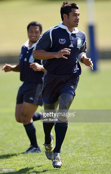 Lome Fa'atau of Samoa shows off his Tatoos as Earl Va'a looks on during training at Arena Joondalup on October 3 2003 in Perth Australia