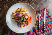Lomo saltado traditional peruvian plate close up