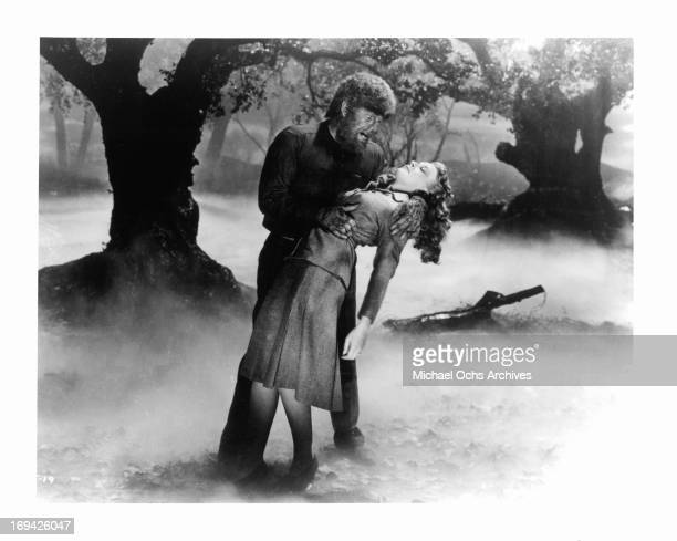 Lon Chaney Jr about to take a bite out of Evelyn Ankers in a scene from the film 'The Wolf Man' 1941