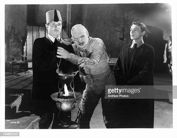 Lon Chaney Jr as a mummy leans against unknown actor in a scene from the film 'The Mummy's Curse' 1944