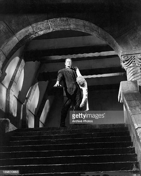 Lon Chaney Jr as the monster holding body at top of stairs in a scene from the film 'The Ghost Of Frankenstein' 1942