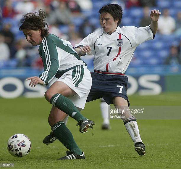 Karen Burke of England tries to tackle Verena Hagedorn of Germany during the FIFA 2003 Woman's World Cup Qualifing match between England and Germany...
