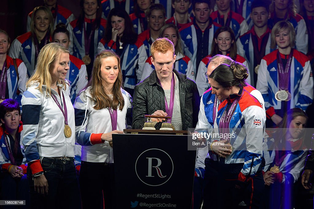 London 2012 Olympic athletes from Team GB Anna Watkins, Helen Glover, Greg Rutherford, Barney Storey and Sarah Storey switch on the Christmas lights at Regent Street on November 13, 2012 in London, England.
