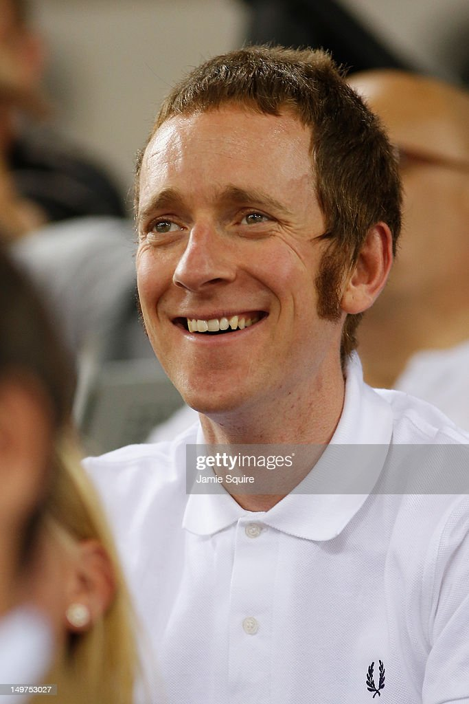 London 2012 Olympic gold medalist and 2012 Tour de France winner <a gi-track='captionPersonalityLinkClicked' href=/galleries/search?phrase=Bradley+Wiggins&family=editorial&specificpeople=182490 ng-click='$event.stopPropagation()'>Bradley Wiggins</a> of Great Britain smiles as he watches the track cycling on Day 7 of the London 2012 Olympic Games at Velodrome on August 3, 2012 in London, England.