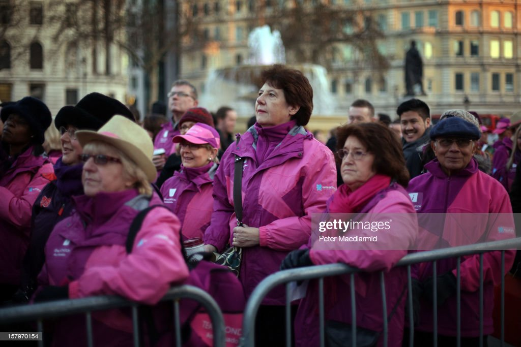 London 2012 Olympics volunteers watch a Christmas carol concert held in Trafalgar Square on December 8, 2012 in London, England. The concert is being held to thank the London Olympic 2012 volunteers. London Mayor Boris Johnson thanked the 8000 which he said 'proved to be the beating heart of the Games'.