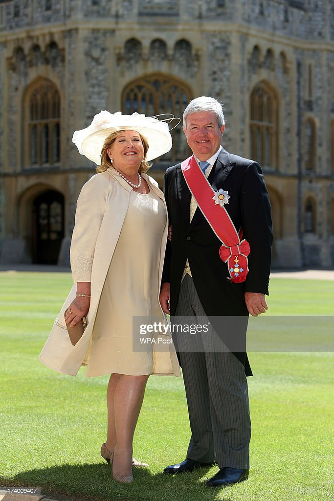 London 2012's deputy chairman Sir Keith Mills with his wife Maureen after he is made Knight Grand Cross of the Order of the British Empire by Queen Elizabeth II during an Investiture ceremony at Windsor Castle on July 19, 2013 in Windsor, England.