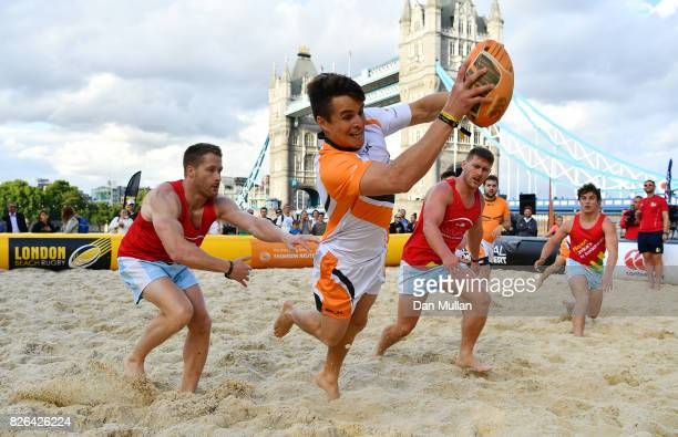 London Air Ambulance compete against Thompson Reuters during day one of the London Beach Rugby 2017 at Potters Field Park on August 4 2017 in London...
