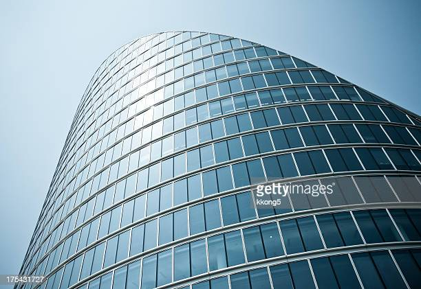 london architecture: classic modern bent building facade
