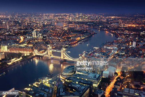 London at night with urban architectures and Tower Bridge : Stock Photo