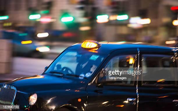 UK, London, Black cab at night