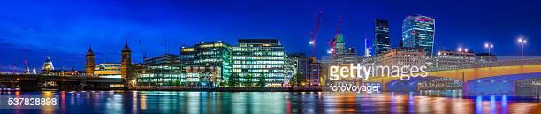 London Bridge City skyscrapers illuminated at night River Thames panorama