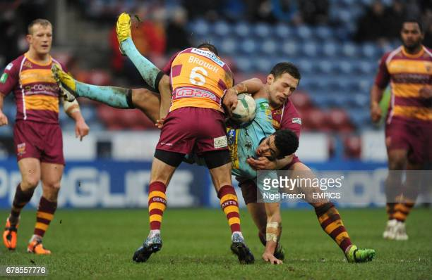 London Broncos' Kieran Dixon is tackled by Huddersfield Giants' Danny Brough and Shaun Lunt