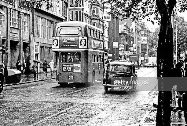 London bus in Charing Cross Road central London June 1977 carrying posters for the English punk rock band the Sex Pistols' single 'God Save The...
