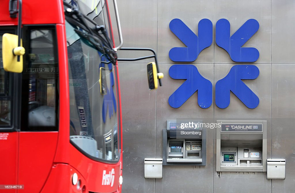 A London bus passes automated teller machines (ATM) outside a Royal Bank of Scotland Group Plc (RBS) branch, in London, U.K., on Friday, Feb. 22, 2013. RBS, Britain's biggest publicly owned lender, was fined $612 million by regulators in the U.K. and the U.S. for rigging the London interbank offered rate and similar benchmarks. Photographer: Chris Ratcliffe/Bloomberg via Getty Images