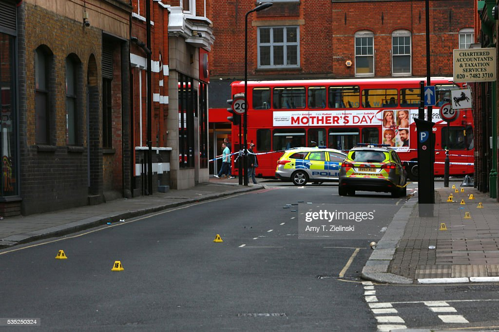 A London bus passes by as police vehicles are parked inside a cordoned off section of Greenland street as a murder investigation is underway in Camden on May 29, 2016 in London, England. Reportedly a stabbing took place in the area leaving one man dead after being taken to the hospital.