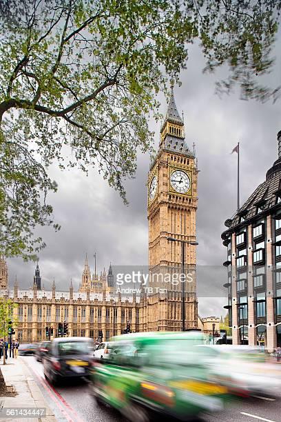 London cabs rushing past Big Ben