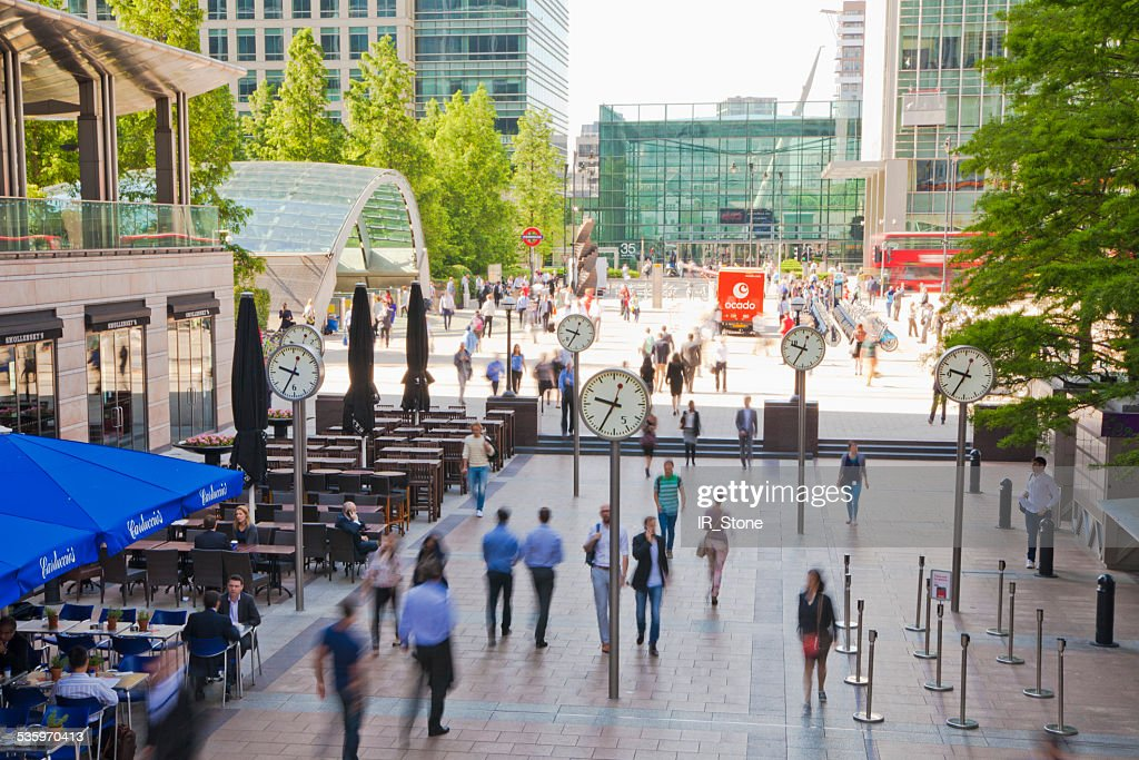 London, Canary wharf square with walking people : Stock Photo