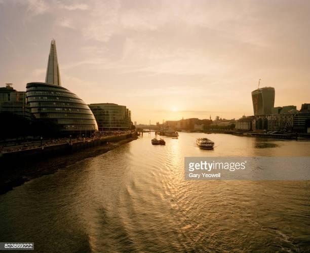 London city skyline along River Thames at sunset