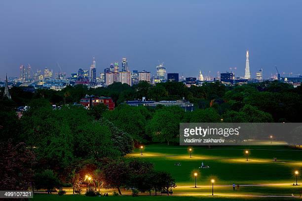 London city skyline and park landscape at twilight