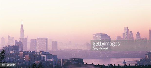 London city skyline and River Thames in the fog : Bildbanksbilder
