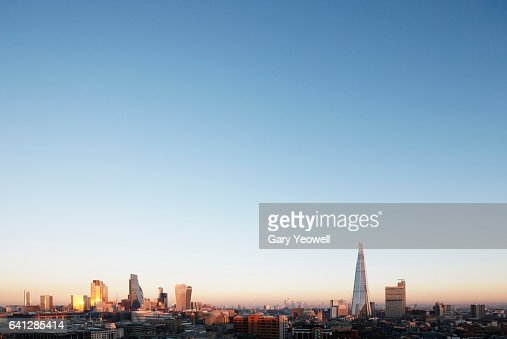 London city skyline at sunset : ストックフォト