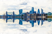 London cityscape with dramatic clouds with its reflection from river Thames