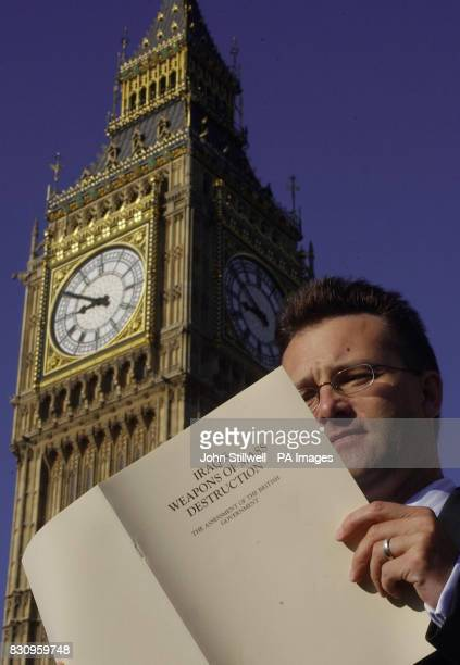 A London communter reads a copy of the Government's white paper on Iraq's weapons of mass destruction in the shadow of Parliamnet this morning...