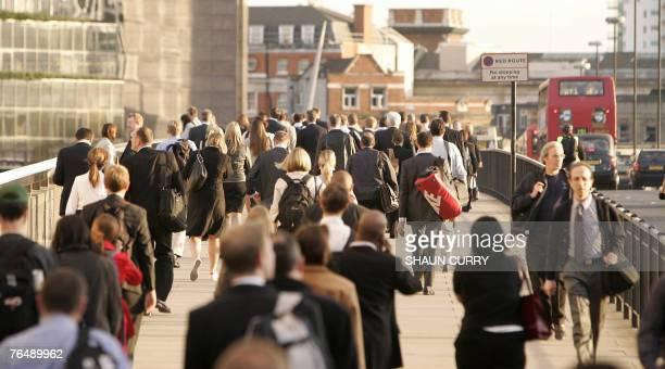 London commuters cross London Bridge 03 September 2007 after the Rail Maritime and Transport union went ahead with the 72hour walkout at 600 pm in a...